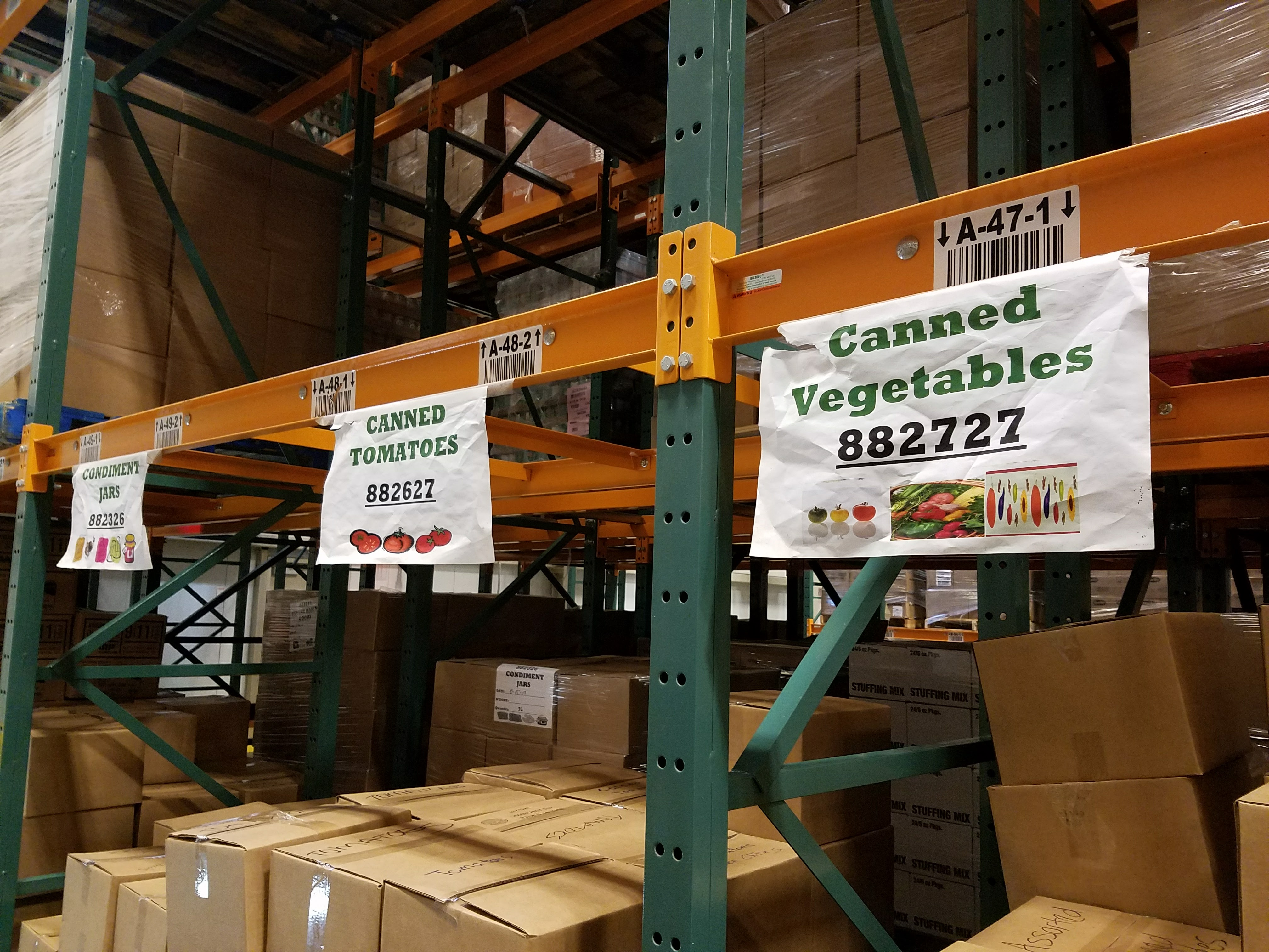 Canned goods are sorted and labeld for nutritional value in CAFB's impressive warehouse.