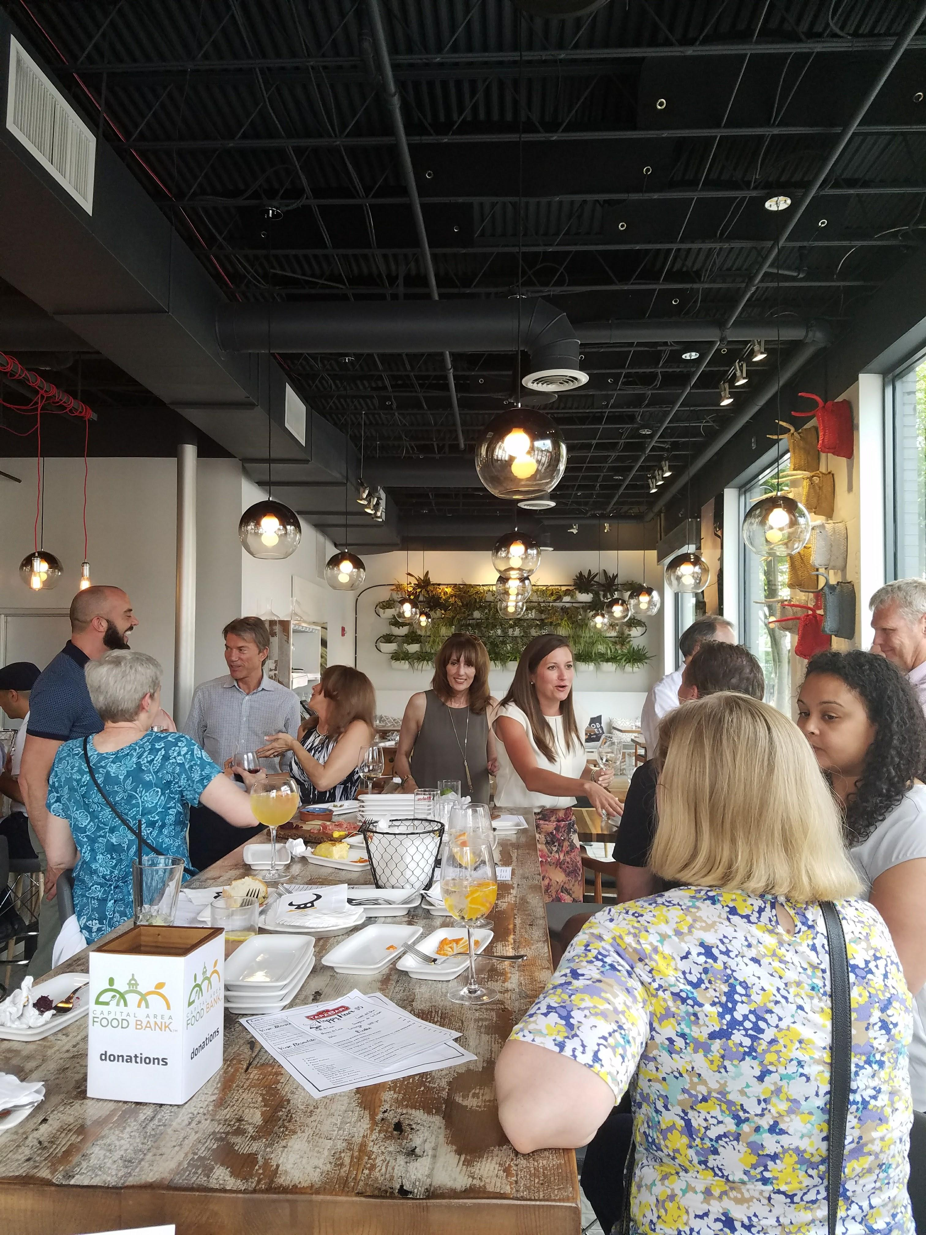 DelCor celebrated its 15th annual food drive with donors and CAFB staff at TapaBar in Bethesda.