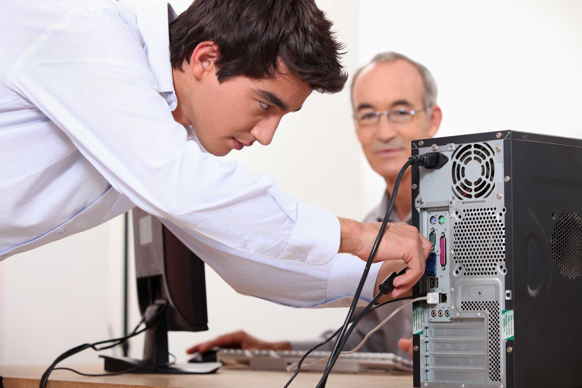man_fixing_computer