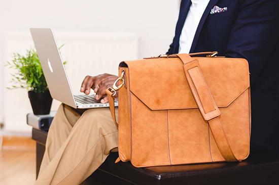 pexels-photo-936081-businessman-briefcase-laptop